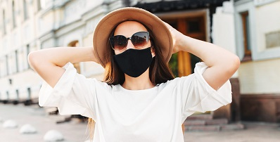 Female wearing a face mask with sun hat